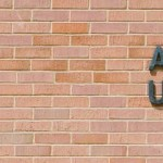 "A photo of a brick wall with metal words ""A. Ray Olpin University Union"" mounted into the brick."