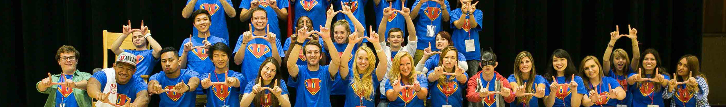 A group photo of student volunteers all wearing matching volunteer t-shirts at a UPC event.