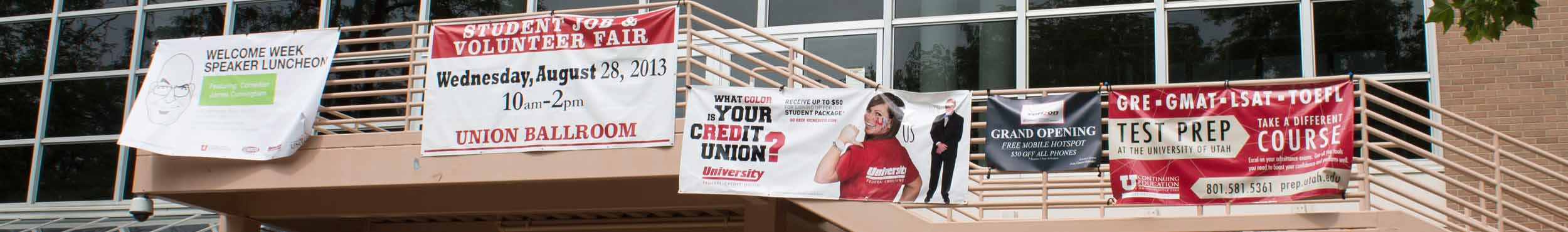 A photo of advertisement banners hanging from the Union staircase.