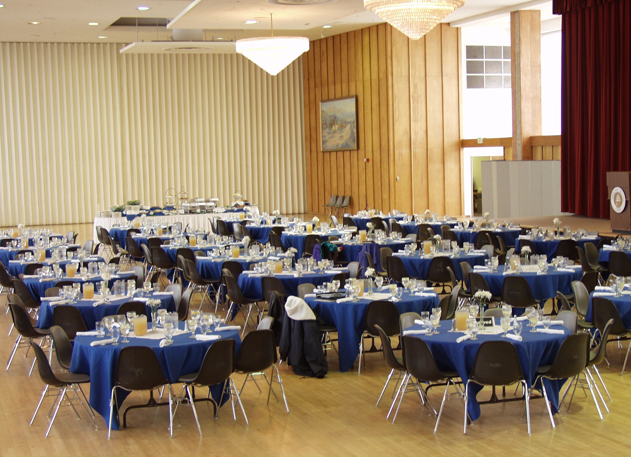 A photo of the ballroom filled with tables.