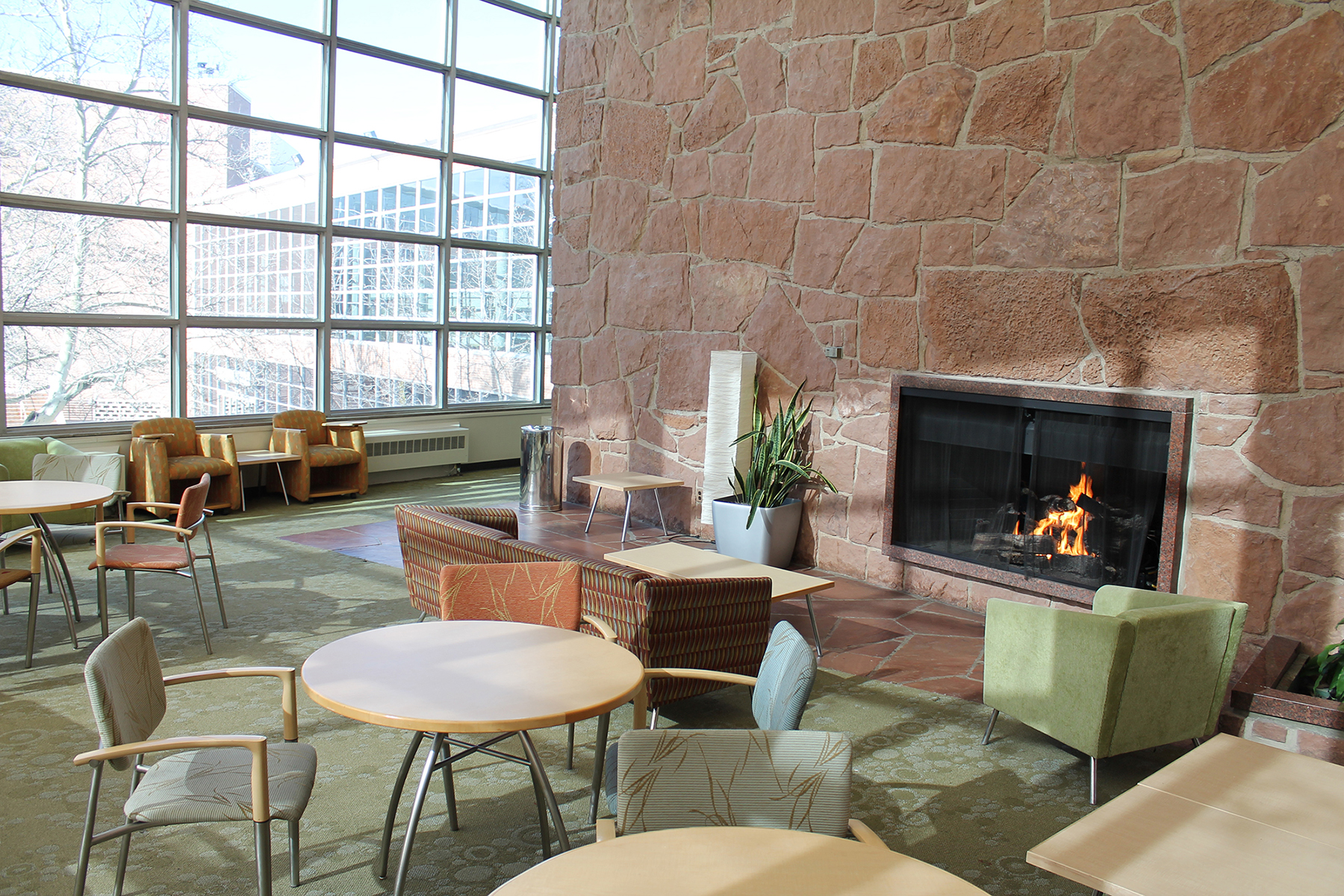 A photo of the student lounge fireplace while the fire is lit.